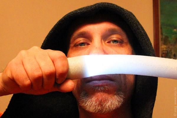 Со световым мечом.